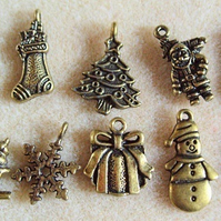 10 Christmas charms, antique gold plated