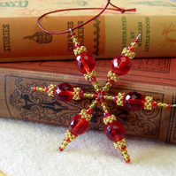 Beaded Christmas snowflake decoration, red and gold