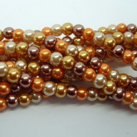 60 glass pearls, 6mm, golden mix