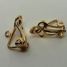 Pair of large clip-on earrings with loop, gold plated.
