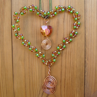 Copper wire heart decoration, amber, topaz, gold and green beads, crystal heart