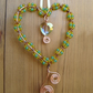 Copper wire heart decoration, green, yellow and topaz glass beads, crystal heart