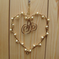 Small wire heart decoration, cream and gold.