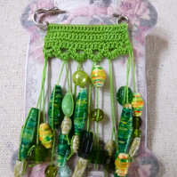 Green Crochet scarf shawl pin Brooch UK featuring hand rolled paper beads