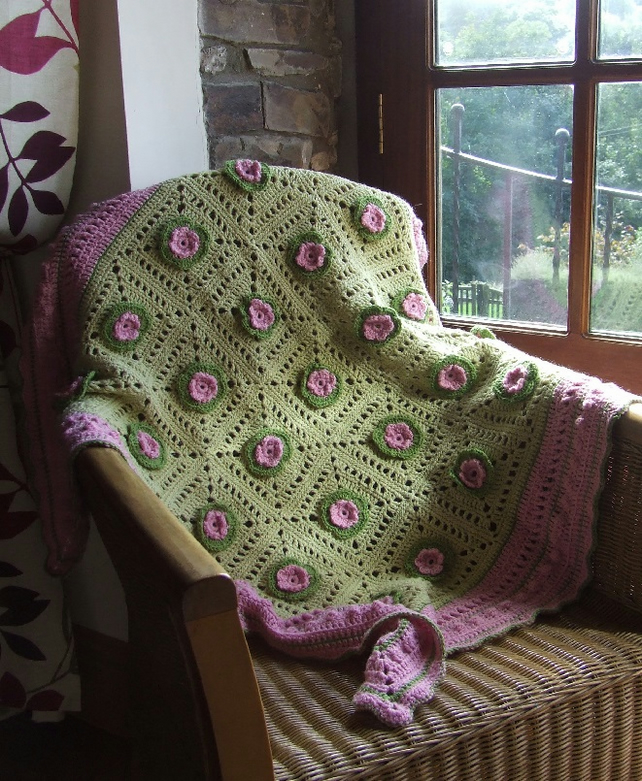 Green and pink crochet blanket with raised flowers