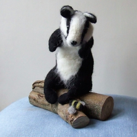 Needle-felt badger and bee on log