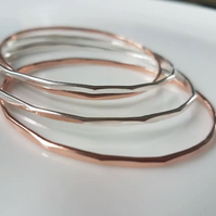 Silver bangle stacking with multi edged finish, copper available too