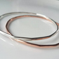 Copper bangle stacking with multi edged finish, sterling silver available too