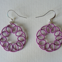 Magenta circular dangle earrings