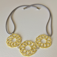 Pastel yellow spiral necklace