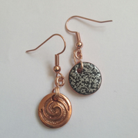 Swirl Earrings with a black and silver textured back