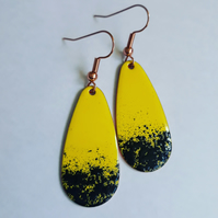 Yellow and black oval drop earrings.