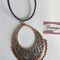 Boho style copper and silver coloured  pendant necklace