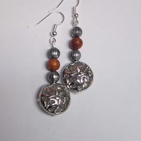 Flat silver round bead earrings.
