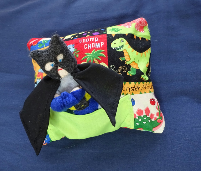 tooth fairy pillow and Batman toy