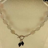 Rose quartz and silver plated bead two way necklace with black crystal dangles