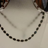 Black oval bead two way necklace with blue zircon dangles