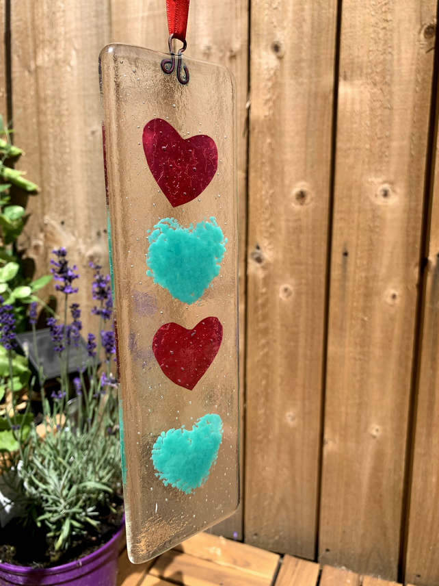 Fused glass hanging with copper foil and green hearts