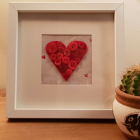 Button love heart in frame