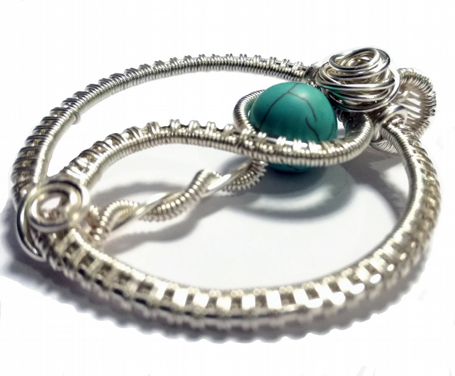 Turquoise beaded wire wrapped circular pendant