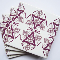 4 x Dark Pink and White Trefoil Pattern Ceramic Coasters with Cork Backing