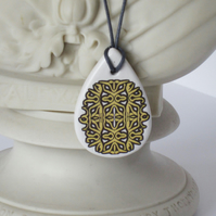 Yellow Rococo Pattern Ceramic Pendant on Grey Cord with Lobster Clasp
