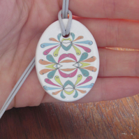 Filigree Petal Design Ceramic Pendant on Light Grey Cord with Lobster Clasp