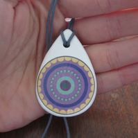 Purple Concentric Circle Pattern Ceramic Pendant on Grey Cord with Lobster Clasp