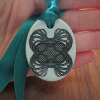 Teal Green Geometric Ceramic Pendant on Adjustable Green Ribbon with Poppers