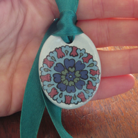 Ottoman Inspired Oval Ceramic Pendant on Adjustable Green Ribbon with Poppers