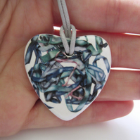 Tousled Ribbon Pattern Heart Shaped Ceramic Pendant on Grey Cord with Clasp