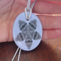 Mauve Stylised Flower Design Ceramic Pendant on Grey Cord with Lobster Clasp