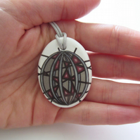 Geometric Artwork Design Oval Ceramic Pendant on Grey Cord with Lobster Clasp