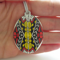 Red Black and Yellow Oval Ceramic Pendant on Grey Cord with Lobster Clasp