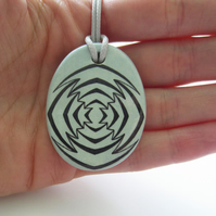Jagged Target Design Oval Ceramic Pendant on Grey Cord with Lobster Clasp