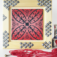 Red Pink and Black North African Inspired Ceramic Tile in Decorated Wooden Frame