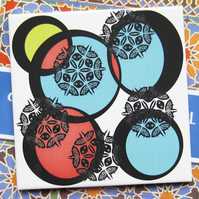 Red, Blue and Yellow Circle Pattern Ceramic Tile Trivet with Cork Backing