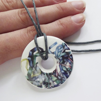 Tousled Ribbon Pattern Donut Shaped Ceramic Pendant on Grey Cord with Clasp