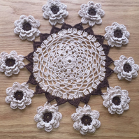 Table decoration crochet mat with intricate layered flowers in brown & beige