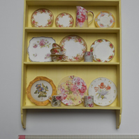 Lovely china displayed on shabby chic shelves created in 1:12th scale
