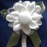 Pure white and silvery grey boutonniere
