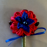 Red and blue special occasion brooch