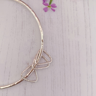Round recycled  sterling silver bangle with 3 triangle charms.