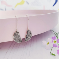 Semi circle, half moon dangly earrings with petal pattern. Sterling silver.