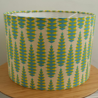 A handmade 30cm drum fabric lampshade in yellow 'Aloe Vera' fabric.