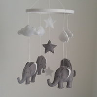 Grey elephants with clouds and stars