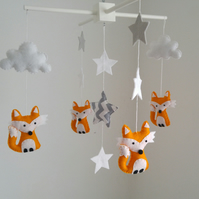 Fox nursery mobile with grey and white stars and a big chevron star