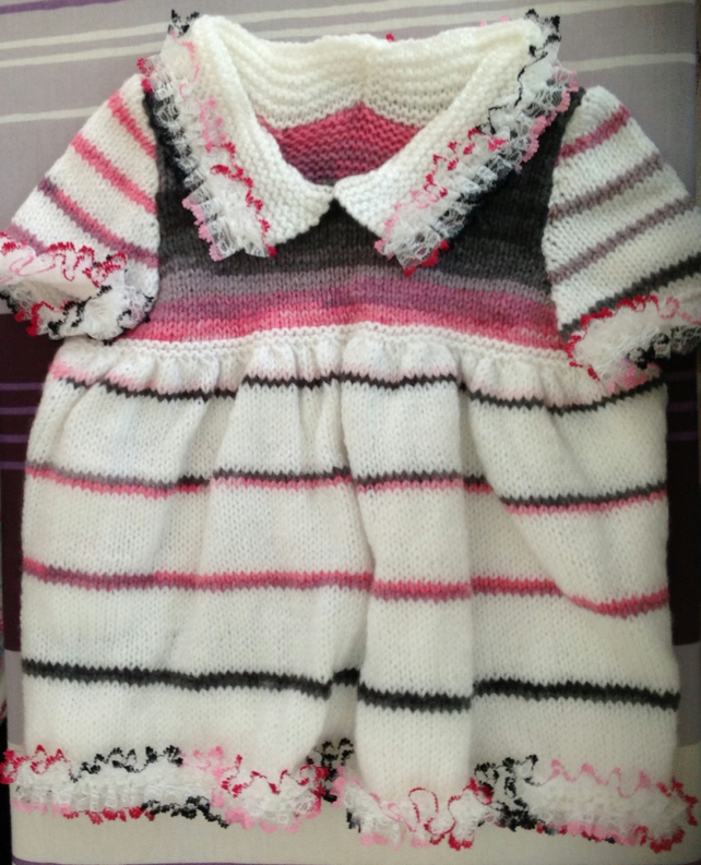 Hand knitted dress to fit a 0 - 3 baby girl