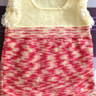 Hand knitted pinafore dress to fit a baby girl aged 6 - 9 months old