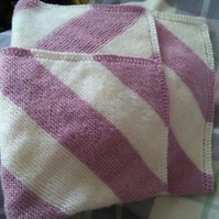 Hand knitted striped blanket